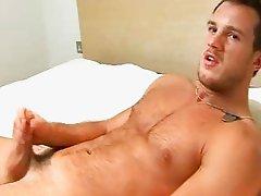 Hot hunk enjoying himself on bed