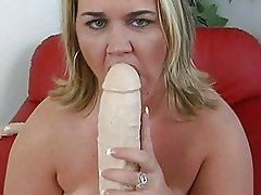 Provocative blonde momma with big tits strips and masturbates