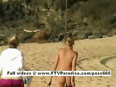 Carli Independent beautiful blonde girl playing on the beach
