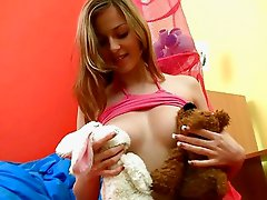 Foxy teen chick plays with her teddy bear toy