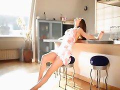 Teen wow model teasing in a kitchen
