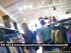 Hot brunette slut in a clothes shop