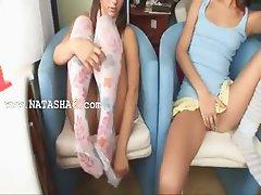 Two cuties masturbating on the bedstead