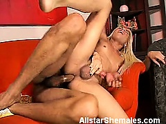 The scene opens with blonde shemale vixen Shakira gobbling