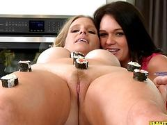 A naughty lesbian couple plays with food before sensual licking