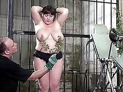 Chubby girl released from her cage to be humiliated BDSM