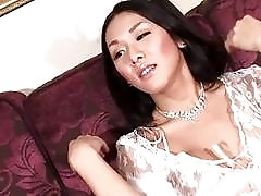 Sexy Asian t-girl shows off and beats her meat