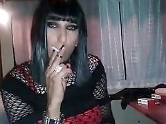 Horny transsexual smokes and masturbates