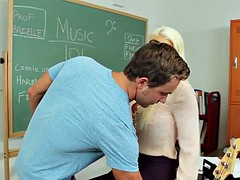 Hot blonde teacher in sexy stockings fucked in the classroom