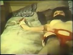 Vintage raven tied to the bed by three nasty guys