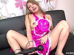 Maid spreads her legs and plays with a vibrator