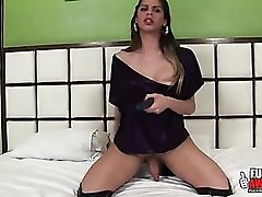 Thigh high leather boots on a toy fucking tranny