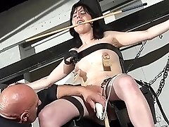 Bald dude teases a girls tight little pussy BDSM style