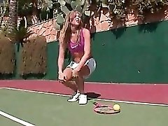 Sporty tennis girl strips on court