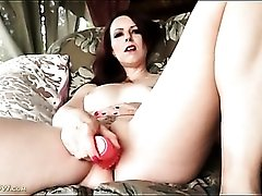 Mom with a tramp stamp fucks a toy outdoors