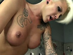 exotic redhead gets fucked by a short haired blond transsexual's cock
