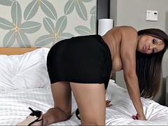 francesca le posing in a skin-tight black dress