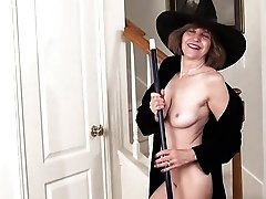 Retro granny in witch suit hotly masturbates pussy with broom
