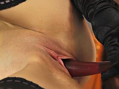 toy loving domina plays with her tight cunt