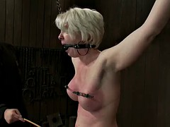 blonde's flesh reddens from spanking in bdsm vid