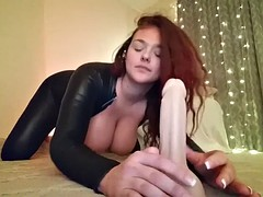 redhead with big tits sucking a dildo