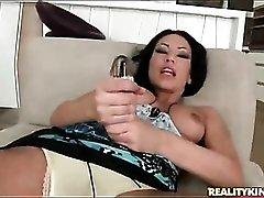 Mya Diamond sucks dildo and gets fingered