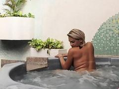 Horny Tranny Pamela Lenvisk Masturbates Her Big Cock in a Whirl Pool Tub