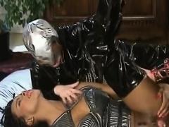 Ebony slut in latex takes two white schlongs