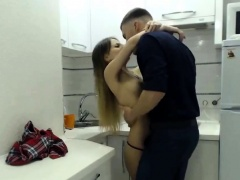 Beautiful teen with perky boobs gets nailed in the kitchen