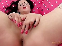 Seamed stockings are sexy on a finger fucking girl