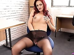 Slutty redheaded secretary teasing in pantyhose