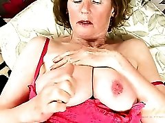 Granny in hot pink lingerie has a huge clit piercing