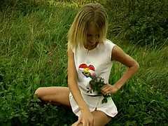 skinny blonde teen masturbates with a dildo outdoors