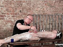 Twink wrapped in plastic gets a sexy handjob