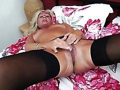 Cute tanned granny masturbates in stockings