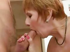 Hot granny fucking a boy in the kitchen