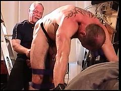 Pounding a butt plug up muscle hunk ass.