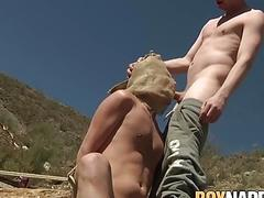Bound young man gets throat fucked by hung sadist outdoor