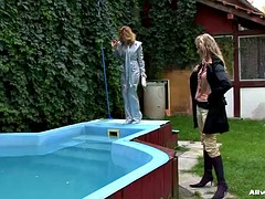 two babes fight in a pool and get wet