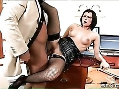 Office beauty in fishnet stockings fucked
