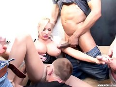 Smashing blonde woman, Michelle Thorne is getting gangbanged for the first time ever and enjoying it