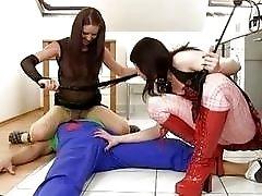 Two dominatrix chicks smash an unlucky plumber boy BDSM threesome