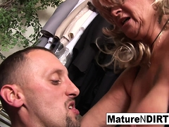 Granny fucks a younger man in the fitting room