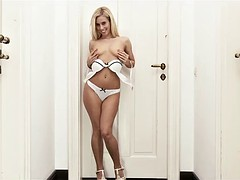 Sexy blue-eyed blonde in high heels rubs her wet pussy