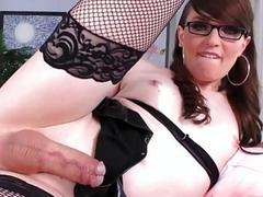 Beautiful tranny with glasses penetrates herself with big red dildo